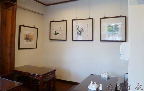 潘樵位於四季麵店裡的畫作