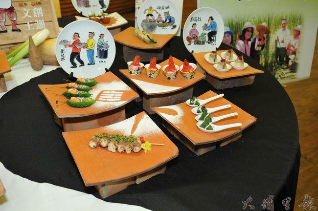 台灣美食展南投館主題訂為「田甜的南投」,已故本土詩畫家王灝的作品,也融入美食當中。(柏原祥攝)