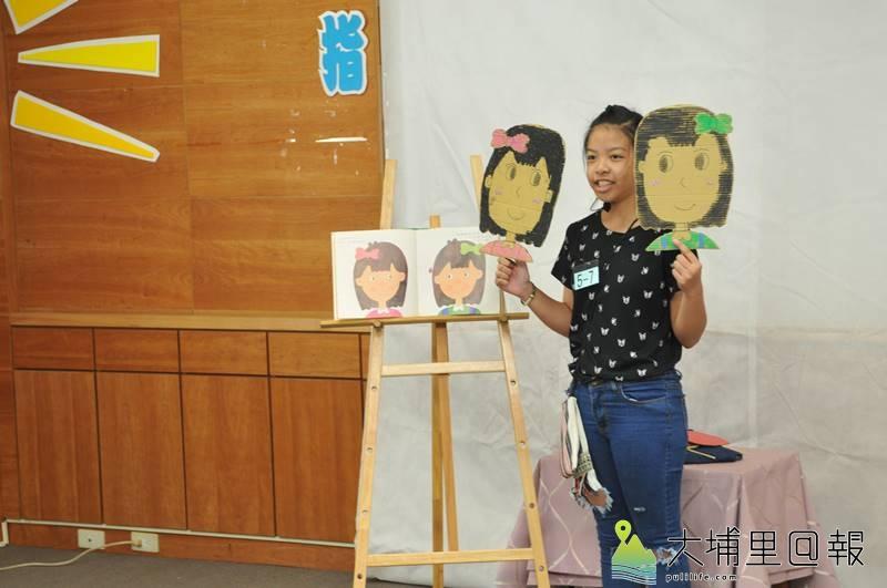 台灣彩虹雙福協會課輔班舉辦說故事比賽,讓弱勢家庭孩子上台展現自信與學習成果,有的孩子還會自製道具。(柏原祥 攝)